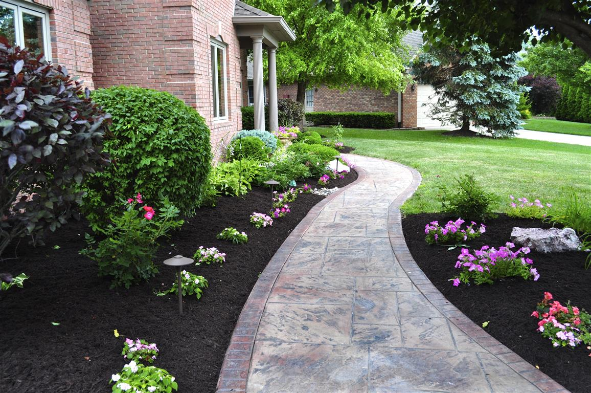 Need mulch we ve got you covered diversified services ri for Dark brown landscape rock